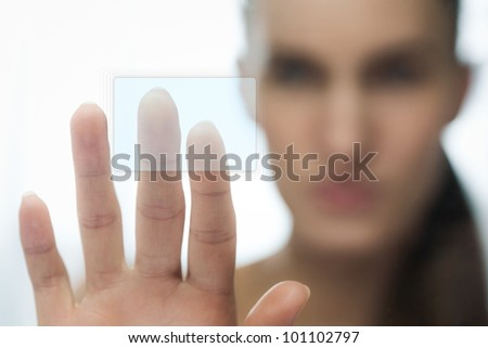 Girl touching sensor screen, isolated on white - stock photo