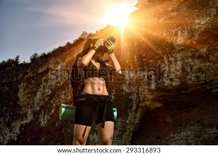 girl tourist with a camera - stock photo