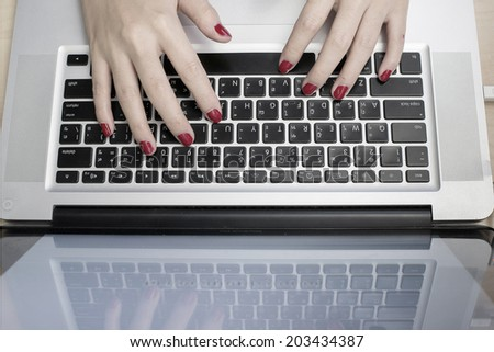 Girl typing on computer keyboard - stock photo