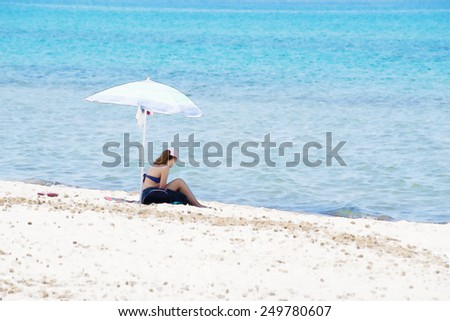 girl under the umbrella by the sea. Water color effect - stock photo