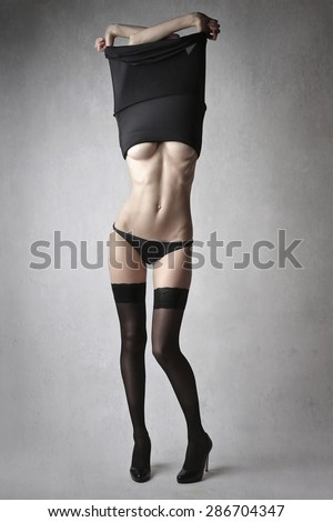 Girl undressing herself - stock photo