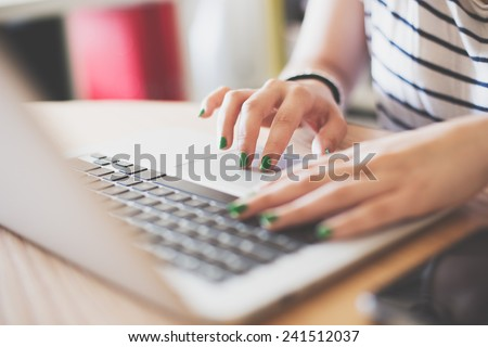Girl using her laptop in her house. - stock photo