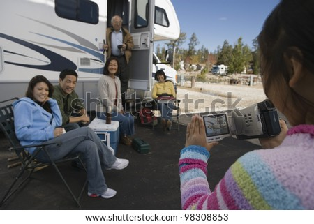 Girl Videotaping Her Family Vacation - stock photo