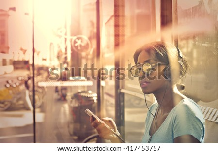 Girl waiting at the bus stop - stock photo