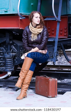 girl waiting for landing on the platform in the train - stock photo