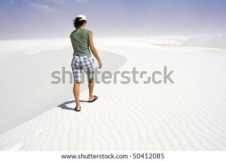 Girl walking dunes - White Sand Dunes National Park - stock photo