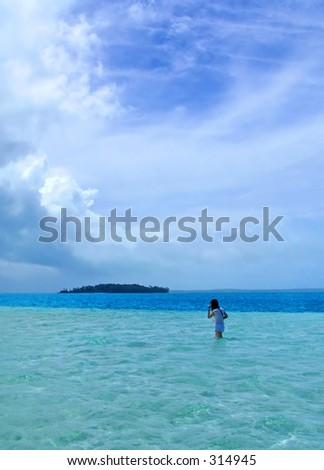 Girl Walking in Shallow Lagoon - Cook Islands - stock photo