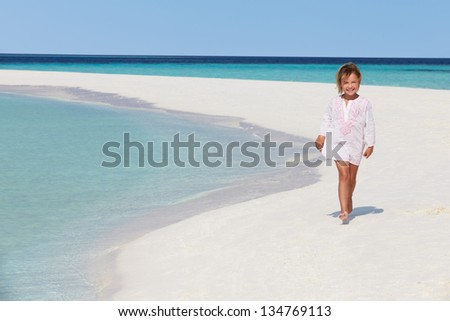 Girl Walking On Beautiful Tropical Beach - stock photo