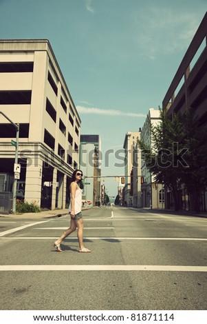 Girl walking streets of Charleston, West Virginia - stock photo