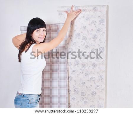 girl wallpaper glues, repair - stock photo