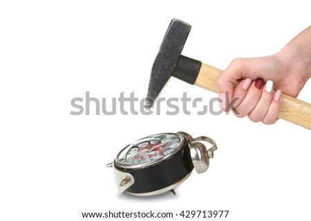 girl wants to break an old clockwork alarm clock with a hammer on a white isolated background - stock photo