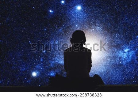 Girl watching the stars. Stars are digital illustration. - stock photo