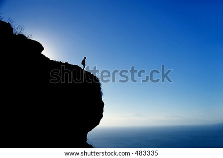 Girl watching the view from the top of the mountain - stock photo