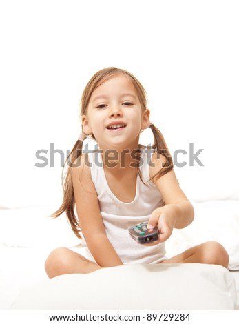 girl watching tv, remote control - stock photo