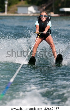 Girl Water Skiing on Lake - stock photo