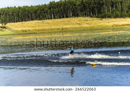 Girl Water-Skiing Summer Young girl water-skiing mountain lake summer landscape - stock photo