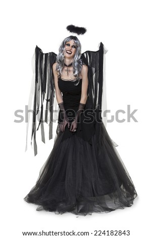 Girl wearing a black halloween costume with wings on white - stock photo