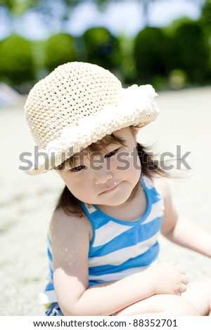 Girl wearing a straw hat - stock photo