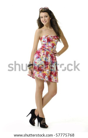 girl wearing a summer dress with sunglasses on her head - stock photo
