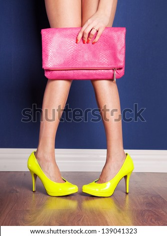 Girl wearing high heels and holding a bag - stock photo