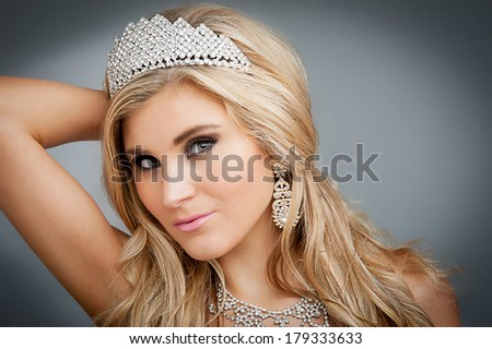 Girl wearing tiara and sparkling jewlery. - stock photo