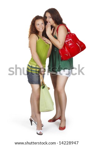 girl whispers girlfriend on ear secret - stock photo