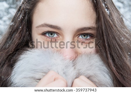 Girl winter. Portrait of a girl. Eyes close up - stock photo