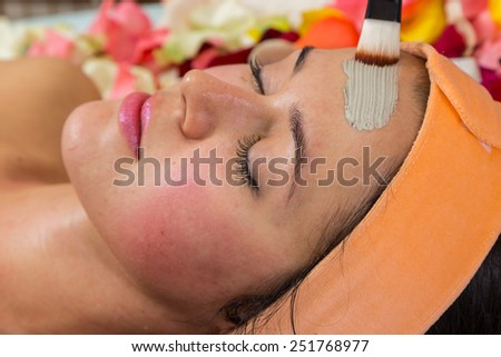 Girl with a beautician at spa salon. Beautician performs cosmetic procedures.applying cosmetic . Cosmetology, facial, beauty - The concept of facial skin care. Article about cosmetology. - stock photo