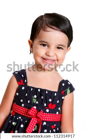 girl with a beautiful dress smiling at the camera - stock photo
