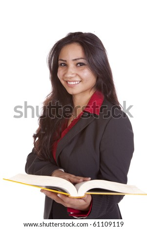 Girl with a book and smiling - stock photo