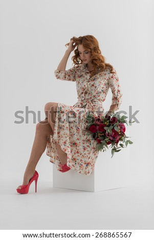 Girl with a bouquet of roses and orchids. Surreal portrait - stock photo