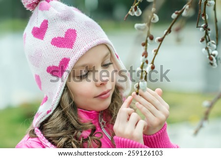 Girl with a branch of willow. Salix. Easter traditions. - stock photo