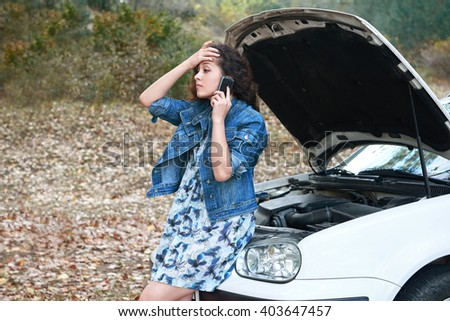 girl with a broken car, open the hood, call for help - stock photo