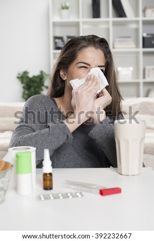 Girl with a cold in the living room - stock photo