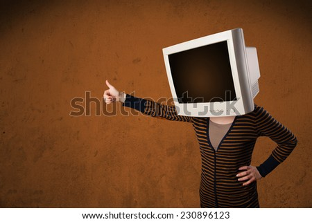 Girl with a computer monitor on her head and empty brown copyspace - stock photo