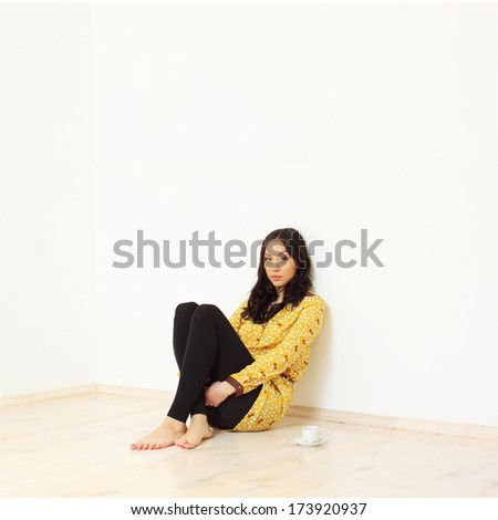 Girl with a cup of coffee - stock photo