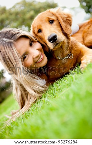 Girl with a cute puppy dog outdoors - stock photo