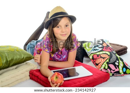 girl with a digital tablet and an apple in his hand - stock photo