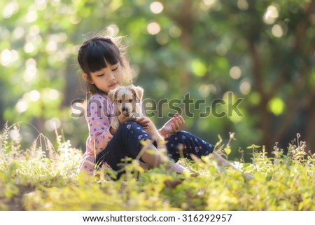 Girl with a dog. - stock photo