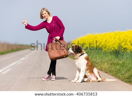 Girl with a dog hitchhike - stock photo