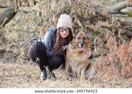 girl with a dog in the park - stock photo