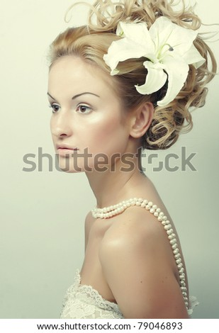 Girl with a flower in her hair - stock photo