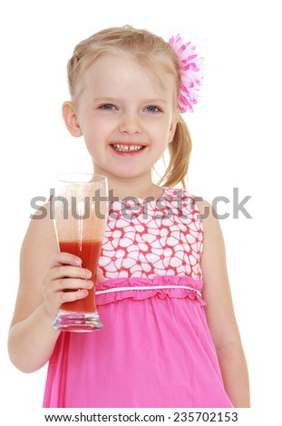girl with a glass of tomato juice which she holds in her hands.White background, isolated photo. - stock photo