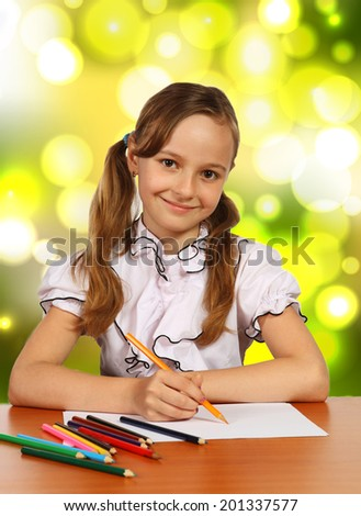 girl with a pencil next to a summer background - stock photo