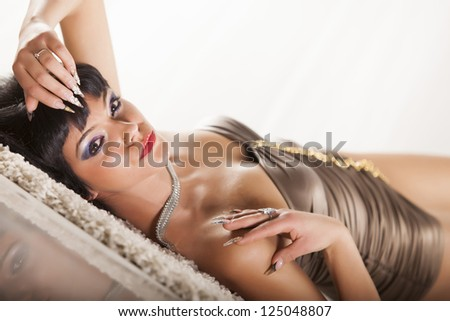 Girl with a scar on the shoulder laying on the flor - stock photo