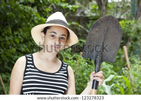 girl with a shovel facing the camera - stock photo