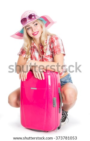 Girl with a suitcase going traveling - stock photo