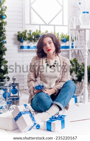 girl with a thoughtful Christmas gifts - stock photo