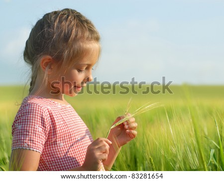 Girl with a wheat plant - stock photo