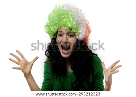 Girl with a wig cheering - stock photo